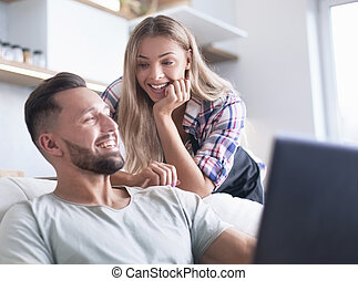close up. young couple looking at laptop screen.