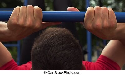 Male Athlete Exercising in Outdoors Gym