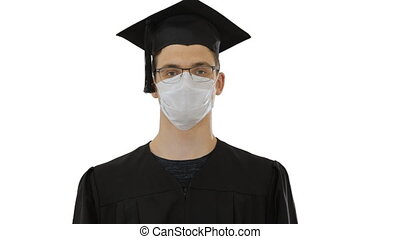 Young man with graduation gown in medical mask on white ...