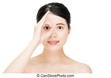 Close up young smiling woman with finger gesture on eyes