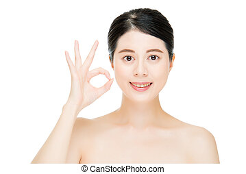 Close up young smiling woman with finger ok gesture