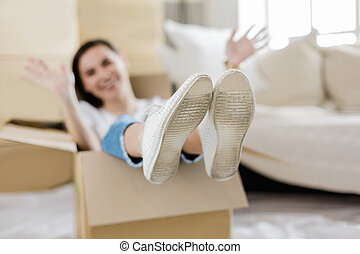 young woman having fun in her new apartment