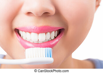 Close up young woman smiling white glamour teeth.