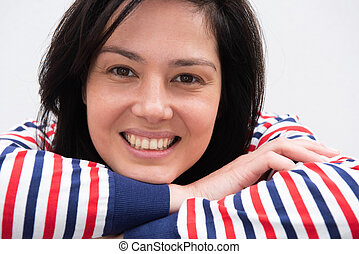 Close up young woman smiling with striped sweater