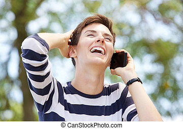 Close up young woman talking on mobile phone and laughing