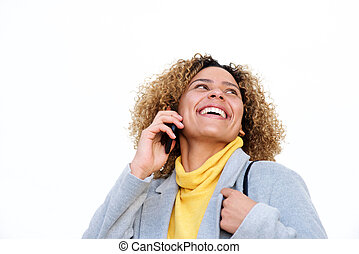 Close up young woman with curly hair laughing with mobile phone