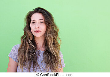 Close up young woman with long hair against green background