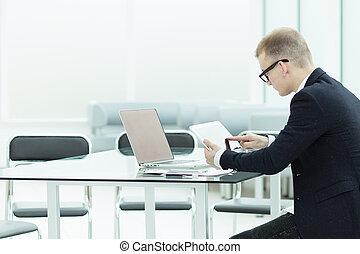 close up.a modern businessman uses a digital tablet.