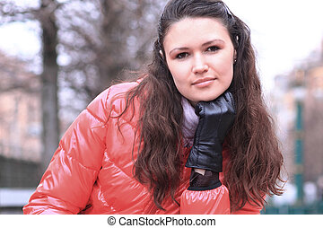 close up.beautiful young woman on the background of a winter city