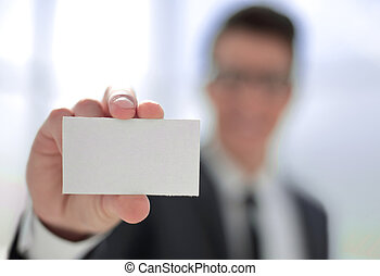 close up.business card in the hands of a businessman.