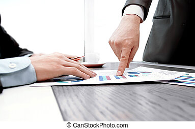 close up.business partners discussing financial project. photo with copy space