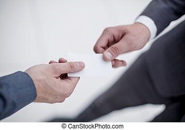 close up.business partners exchanging their business cards