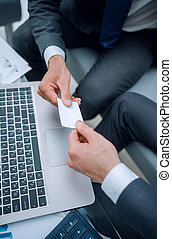 close up.business people exchange their business cards