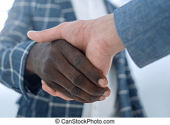 close up.business people shaking hands