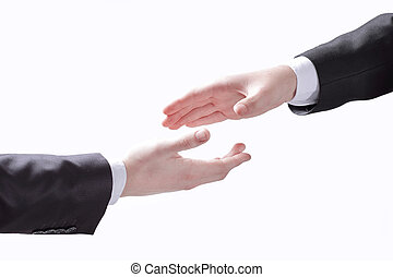 business people stretching out their hands for a handshake