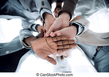 close up.business team folded their hands together.