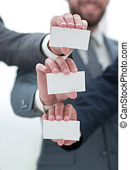 close up.business team showing their business cards