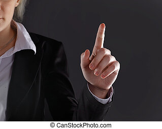 close up.business woman showing index finger up.isolated on black background