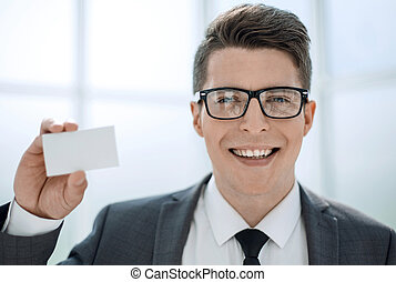 close up.businessman showing his business card