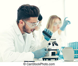 close up.male scientist conducting research in the laboratory
