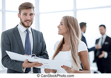 Manager discussing with the client the business document