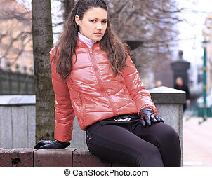 close up.pensive young woman on the background of a winter city