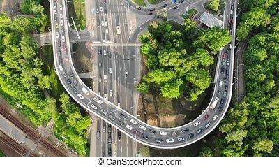 close upper road with jam of multi-level traffic interchange...