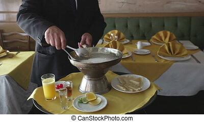 close-ups of a chef preparing crepe suzette in a restaurant