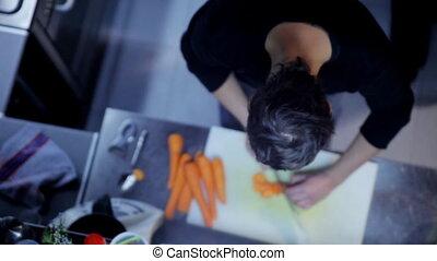 close-ups of chefs preparing food in a restaurant kitchen