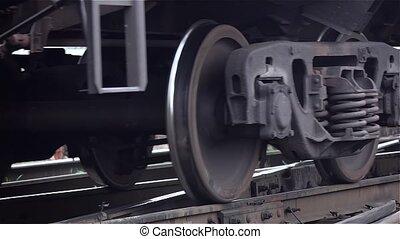 Close-ups of steel diesel railcar train bogie wheels - Old,...
