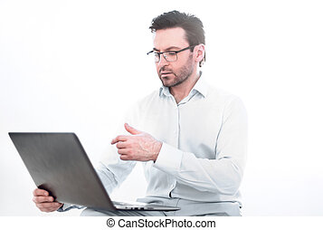 close up.serious businessman typing text on laptop