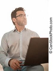 close up.serious businessman with a laptop
