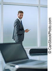 close up.smiling businessman standing in his office.