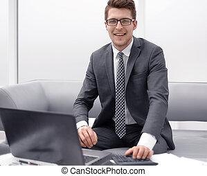 successful businessman sitting at his Desk