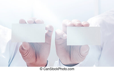 close up.two businessmen showing their business cards