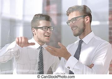 close up.two employees talking standing in the office