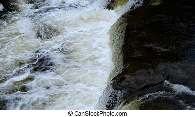 Close up.Water stream of the waterfall. Professional shot in 4K resolution. 02. You can use it e.g. in your commercial video, medical, business, presentation, broadcast