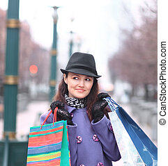 close up.young woman with shopping bags on the background of the city