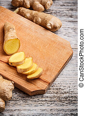 ginger root - Close view of a ginger root on a wood cutting...