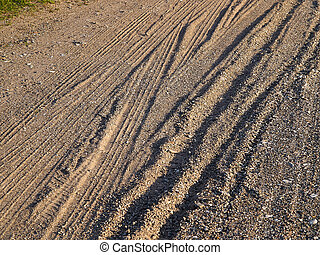 Close view of a sandy dirt road
