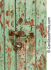 Close view of an old green wooden door.
