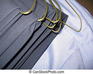 uniforms - close view of basic blue uniforms on hanger