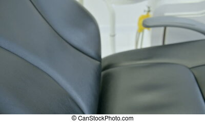 Close view of black dental chair dental equipment in dental ...