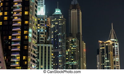 Close View of Dubai Marina Towers in Dubai at night timelapse hyperlapse