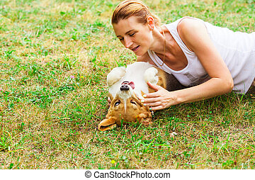 Close view of funny dog and her owner