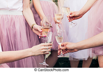 Close view of hands with glasses of champagne