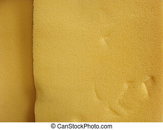 close view of orange industrial foam substance...