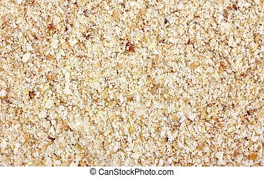 Close view of seasoned bread crumbs - Close view of a layer...