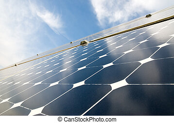 close view of solar panels against a serene blue sky
