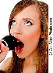 close view of woman singing into karaoke against white background